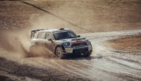 Milton, Ontario, Canada- February 28, 2016. Mini Cooper S Countryman JCW RALLY race car driven by Canadian 2015. Rally Champion Joel Levac, rushing over muddy road in practice run for next season in suburbs of Milton, Ontario. MINI Countryman S JCW RALLY is 4 doors version with upgraded Prodrive engine and suspension. Mini has been around since 1959 and has been owned and issued by various car manufacturers. It is currently distributed as a BMW brand of vehicles. This particular vehicle was driven before by different driver in World Rally Championship (WRC) and won the first place.